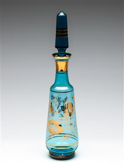 Sale 9253 - Lot 184 - A large mid century blue glass decanter featuring floral gilt decoration and banding (H:42cm)