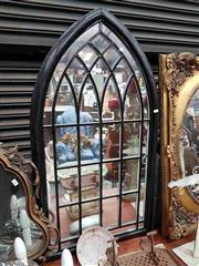Sale 8925 - Lot 1067 - A black painted gothic arch mirror