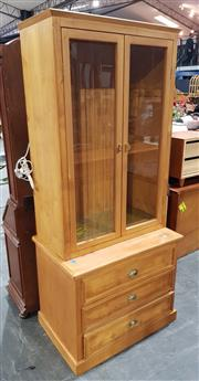 Sale 8971 - Lot 1029 - Pine Effect Display Cabinet with two glass panel doors & three drawers to base (shelves??) (H:210 x W:90 x D:61cm)