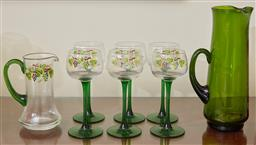 Sale 9098H - Lot 61 - A set of six green stemmed glasses with vine design matching water jug and similar green taller example, Height of glass 17cm