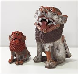 Sale 9188 - Lot 1672 - Pair of graduating painted terracotta foo dogs (h47cm tallest)