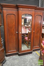 Sale 8267 - Lot 1015 - Late 19th Century Cedar Breakfront Wardrobe, with central mirror & two panel doors, enclosing a fitted interior