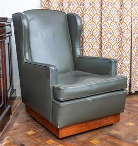 Sale 9195H - Lot 93 - A blue green wing back library chair, Height 105cm