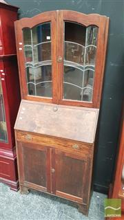 Sale 8404 - Lot 1009 - Timber Bureau Bookcase with Two Leadlight Panel Doors with Single Drawer & Two Doors Below (damage to leadlight)