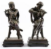 Sale 9015 - Lot 50 - A Good Pair of Spelter Figures of Seated Violin & Flute Players H: 37cm