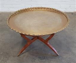Sale 9166 - Lot 1070 - Round brass tray on timber stand side table (h45 x d77cm)