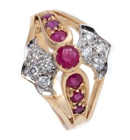 Sale 9177 - Lot 348 - A 9CT GOLD RUBY AND DIAMOND RING; set across the top with 7 round cut rubies flanked by stylised fleur de lis set with 8 round brill...