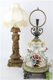 Sale 8524 - Lot 47 - Cherubic Ceramic Lamp Together with Composite Example