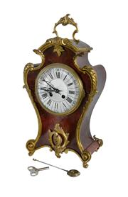 Sale 8620A - Lot 23 - An antique 19th Century French Rococo red boulle and gilt bronze mantel clock  with key and pendulum, H 44cm
