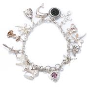 Sale 8982 - Lot 319 - A SILVER CHARM BRACELET; 4.5mm wide belcher links to pierced love heart padlock clasp set with a round cut purple garnet with safety...