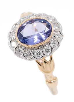 Sale 9177 - Lot 341 - A VICTORIAN STYLE TANZANITE AND DIAMOND CLUSTER RING; featuring an oval cut blue tanzanite of approx. 1.10ct to scalloped surround o...