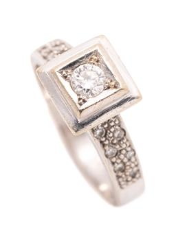 Sale 9260H - Lot 388 - A 14ct white gold diamond ring, square top set with a round brilliant cut diamond of approx. 0.20ct to shoulders set with 12 single...