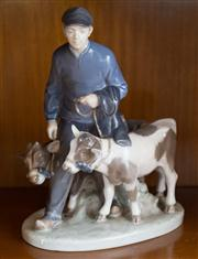 Sale 8313A - Lot 32 - A Royal Copenhagen figure, model number 1858, famer with calves, height 22cm