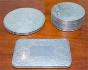 Sale 8341A - Lot 49 - A quantity of silver plate placemats, larger L 25cm