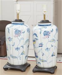 Sale 9090H - Lot 72 - A pair of blue and white ceramic lamps on timber bases, Height 53cm (damage to one)