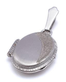 Sale 9194 - Lot 565 - AN 18CT WHITE GOLD LOCKET; one corner with textured crescent motif, size 32 x 16mm. wt. 3.43g.