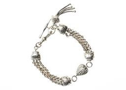 Sale 9221 - Lot 320 - A STERLING SILVER ALBERTINA BRACELET; triple strand belcher chain with a heart link, swivel clasp, T-bar and tassel, length 20.5cm,...