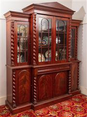 Sale 8804A - Lot 76 - A C19th century cedar breakfront bookcase with tympanum top and four doors with barley half columns above a frieze drawer and four e...