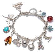 Sale 8999 - Lot 305 - A STERLING SILVER CHARM BRACELET; belcher links to toggle clasp, length 18cm, attached with 12 charms some stone set, 1 synthetic sp...