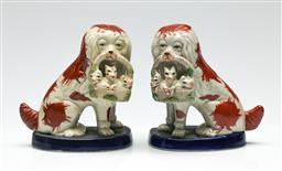 Sale 9209 - Lot 56 - A pair of Staffordshire dogs with baskets (H:14.5cm)