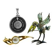 Sale 8060B - Lot 303 - TWO SILVER BROOCHES AND PENDANT; an enamelled silver pelican brooch set with marcasites, a silver coin pendant and a silver gilt mot...
