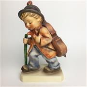 Sale 8456B - Lot 53 - Hummel Figure of a Boy Walking with Cello
