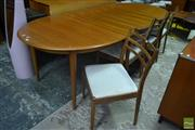 Sale 8528 - Lot 1049 - G-Plan Teak Extension Dining Table with 4 Ladder Back Chairs