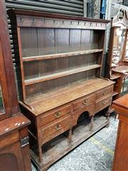 Sale 8792 - Lot 1047 - Late 19th Century Cedar Bookcase, the two doors with glass upper & blind panels below (key in office)