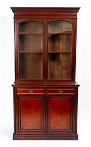 Sale 9044J - Lot 11 - An antique Australian Federation cedar 2 part bookcase in original condition, C: 1900. The multi stepped and reeded cornice above ar...