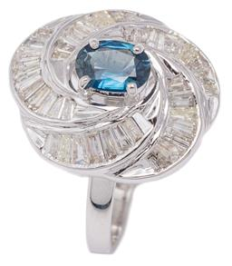 Sale 9132 - Lot 524 - AN 18CT WHITE GOLD SAPPHIRE AND DIAMOND CLUSTER RING; centring an oval cut green blue sapphire of approx. 0.74ct to radiating swirl...