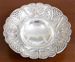 Sale 9140H - Lot 77 - A sterling silver tri-footed bowl, with floral and pierced borders, diameter 20cm, Weight 175g