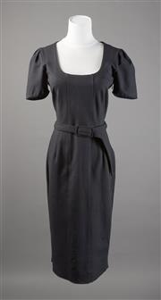 Sale 8499A - Lot 8 - A Hugo Boss (Germany) black stretch scoop neck, below knee dress; belted. Size: S to M.