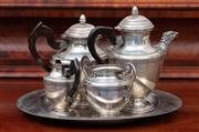 Sale 8815A - Lot 37 - A four piece silver plated coffee set with eagle spout and pineapple finials