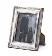 Sale 8890T - Lot 13 - A black and white photograph of a haunting couple withing a Hallmarked Sterling Silver frame, London 1984