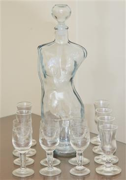 Sale 9098H - Lot 63 - A female form glass decanter together with two sets of six shot glasses.