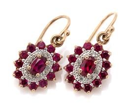 Sale 9107J - Lot 302 - A PAIR OF 9CT GOLD GEMSET EARRINGS; oval clusters each centring oval cut synthetic rubies surrounded by round cut diamond and synthe...