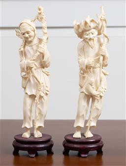 Sale 9140H - Lot 11 - A Chinese carved ivory pair of Elder figures on timber stands, Height 26cm