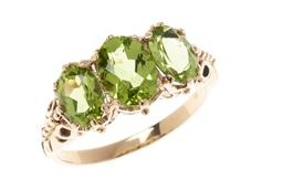 Sale 9213 - Lot 353 - A 9CT GOLD VICTORIAN STYLE PERIDOT RING; claw set across the top with 3 oval cut peridots, size O, top 8 x 14mm, wt. 2.77g.