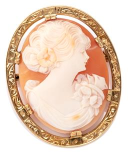 Sale 9124 - Lot 481 - A VINTAGE GOLD CAMEO BROOCH; carved oval shell cameo depicting a classical portrait in a scroll engraved 18ct gold frame, size 37 x...