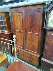 Sale 8617 - Lot 1045 - Early 19th Century Mahogany Gentlemans Press, with two large panel doors enclosing hanging, on a low base fitted with three drawers...
