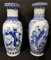 Sale 8971 - Lot 1030 - A Pair of Blue and White Chinese Baluster Vases, with floral and bird cartouche (H:80 x D:33cm)