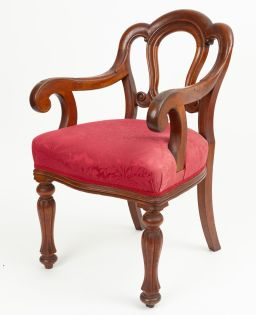 Sale 9150J - Lot 17 - An Australian colonial cedar elbow desk chair by R T Carter C: 1870. The shaped back above foliate carved arms to seat upholstered i...