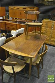 Sale 8350 - Lot 1049 - Teak Extension Dining Table with 6 Spade Back Chairs