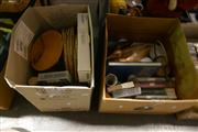 Sale 8362 - Lot 2397 - 2 Boxes of Sundries incl. Books, Videos, Place Mats, Glass Storage Jars, Ceramic Duck, Dishes, Cup Sets, etc
