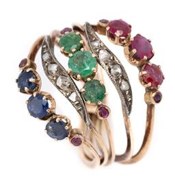 Sale 9107J - Lot 347 - A VINTAGE 14CT GOLD GEMSET MULTIBAND RING; 3 rings set with round cut sapphires, emeralds and rubies between 2 bands set with rose a...