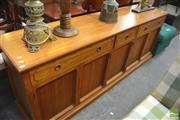 Sale 8341 - Lot 1084 - Timber Sideboard with Four Drawers Above Five Doors