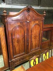 Sale 8666 - Lot 1075 - 19th Century Probably Dutch Mahogany Armoire, with arched & carved cornice, above two arched panel doors with flame veneer, enclosin...