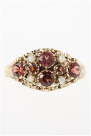 Sale 8756 - Lot 355 - A 9CT GOLD VICTORIAN STYLE GEMSET RING; set with round cut almandine garnets and seed pearls to an engraved shank, size N.