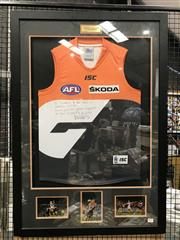 Sale 8805A - Lot 811 - 2013 GWS Giants signed Jersey, with collage, framed