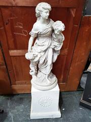 Sale 8925 - Lot 1073 - A composite figural group of a mother and children on a socle base
